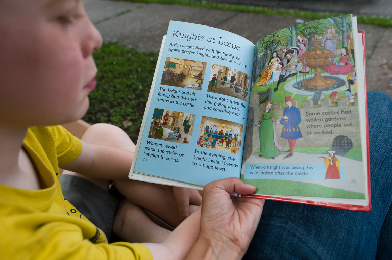 boy with picture book - Documentary Family Photography