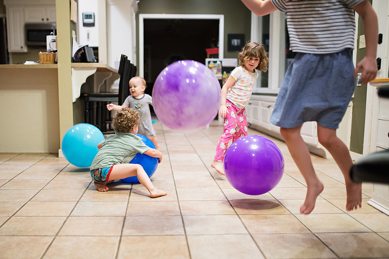 kids with large playground balls - Documentary Family Photography