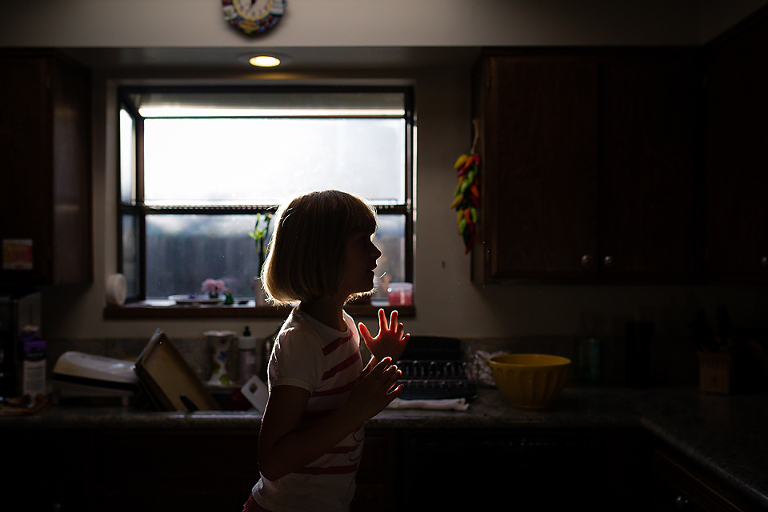 silhouette of girl in window - Documentary Family Photography