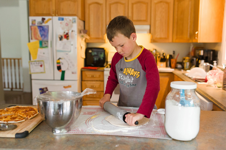 boy rolling out dough - Documentary Family Photography