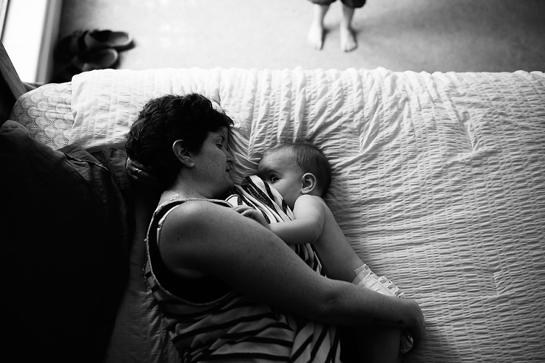 Mom with nursing baby - Documentary Family Photography