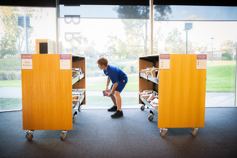 boy in library - Documentary Family Photography