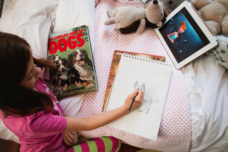 child drawing in sketchbook - Documentary Family Photography