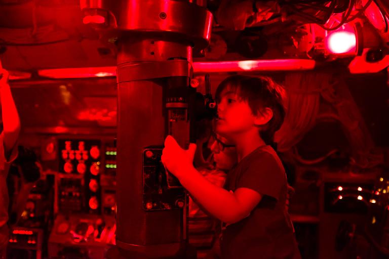 boy looks through periscope -Documentary Family Photography