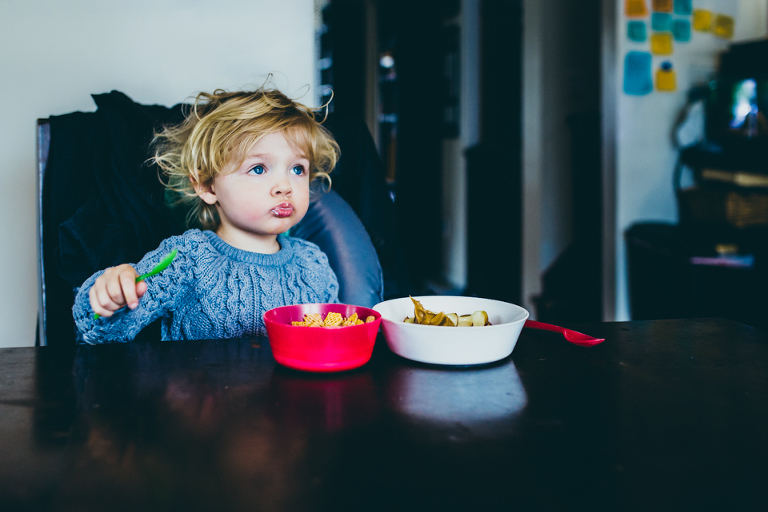 child with bed head and cereal - Documentary Family Photography