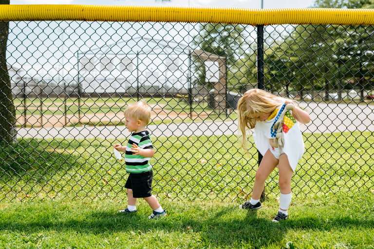 kids near chain link fence - Documentary Family Photography