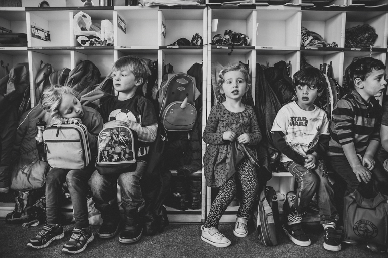 kids waiting in front of cubbies - Documentary Family Photography