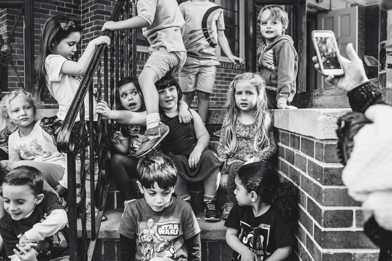 kids gathered on front stoop - Documentary Family Photography