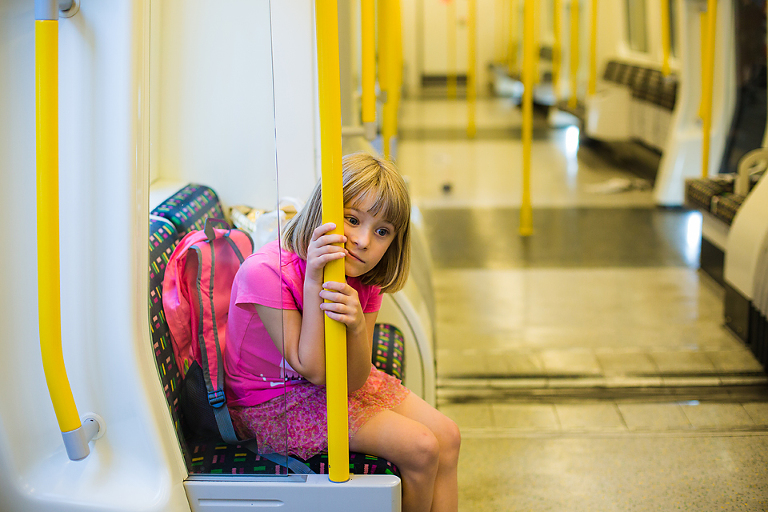tired child on tram - Documentary Family Photography