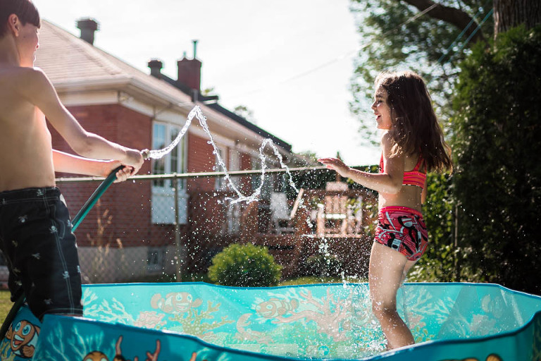 kids playing in hose - Documentary Family Photography