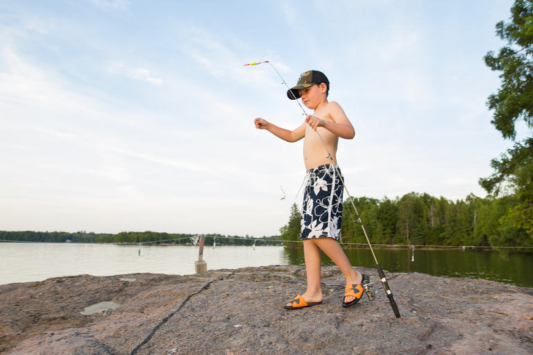 boy with fishing pole - Documentary Family Photography