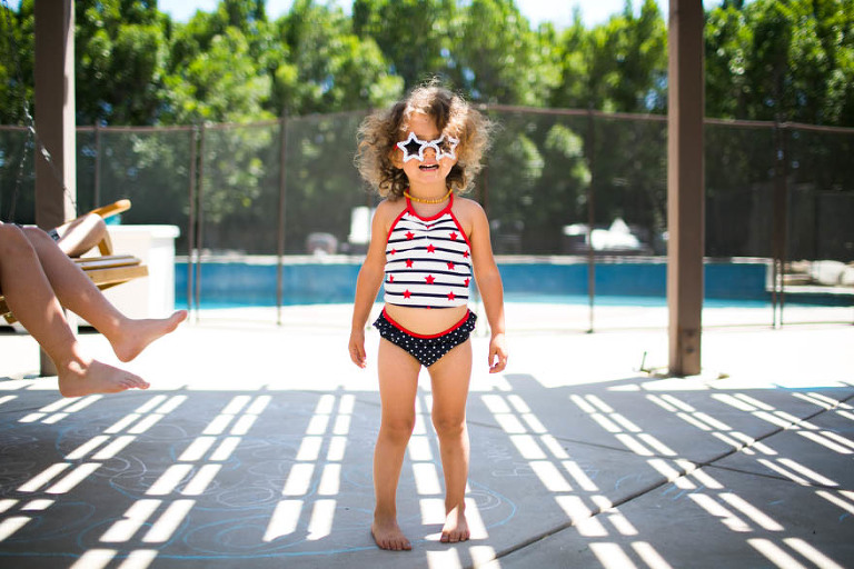 Girl in bathing suit and sun glasses - Documentary Family Photography