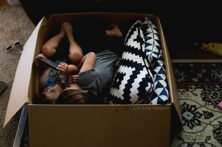 kids cuddled in box - Documentary Family Photography