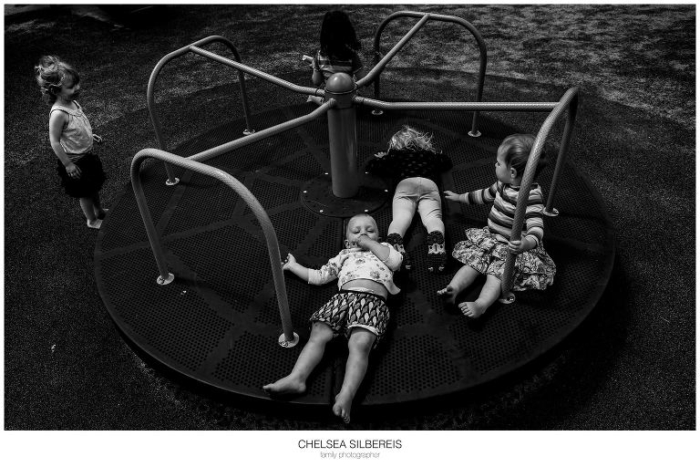 kids on merry go round - Documentary Family Photography