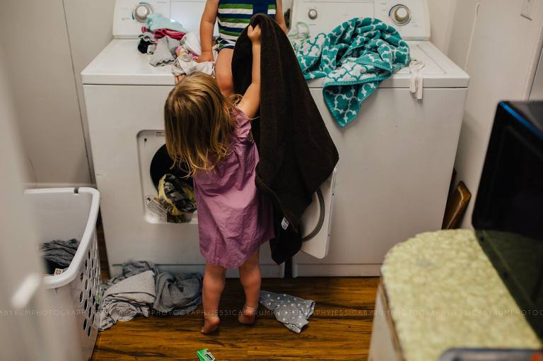 girl with laundry - Documentary Family Photography