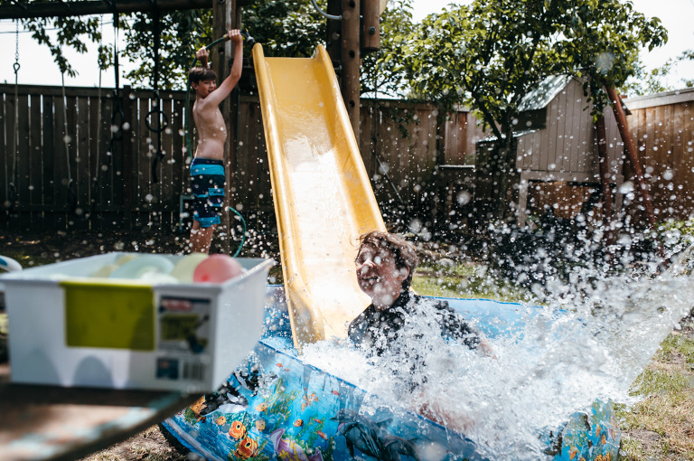 kids with slide and wading pool - Documentary Family Photography