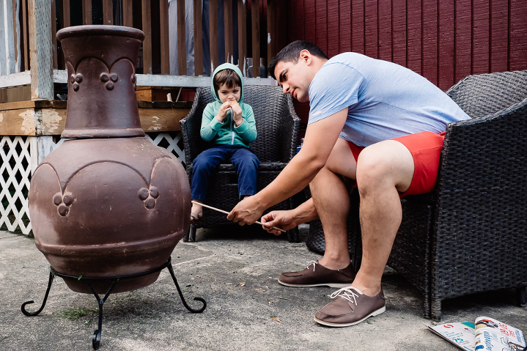 father and son making smores - Documentary Family Photography