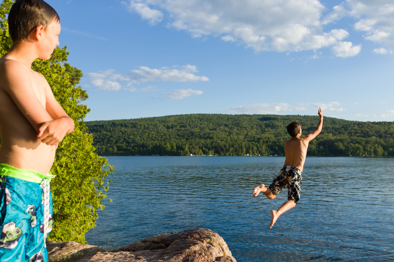 boys jumping into lake -Documentary Family Photography
