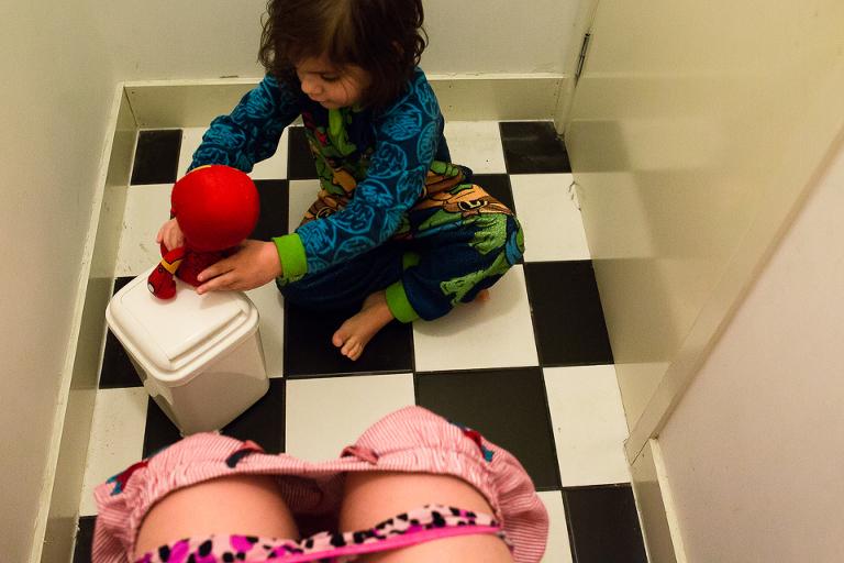 boy plays on bathroom floor - Documentary Family Photography