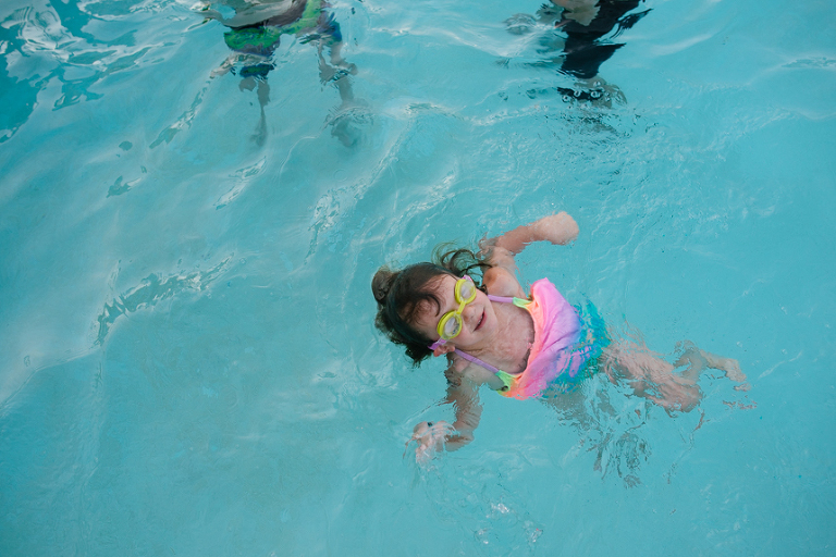 child swims in pool - Documentary Family Photography