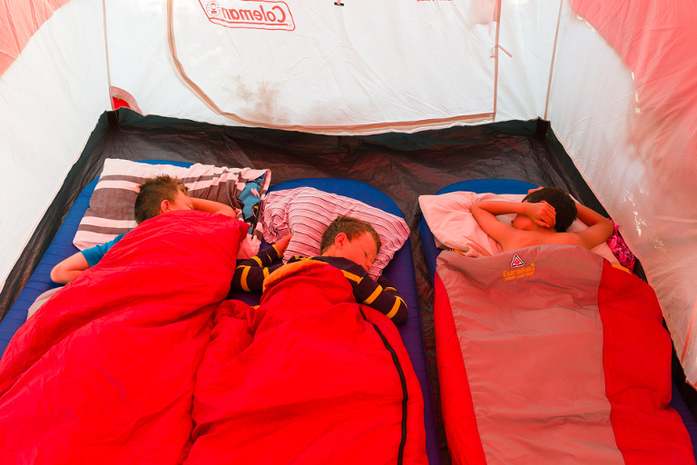 boys in sleeping bag in tent - Documentary Family Photography