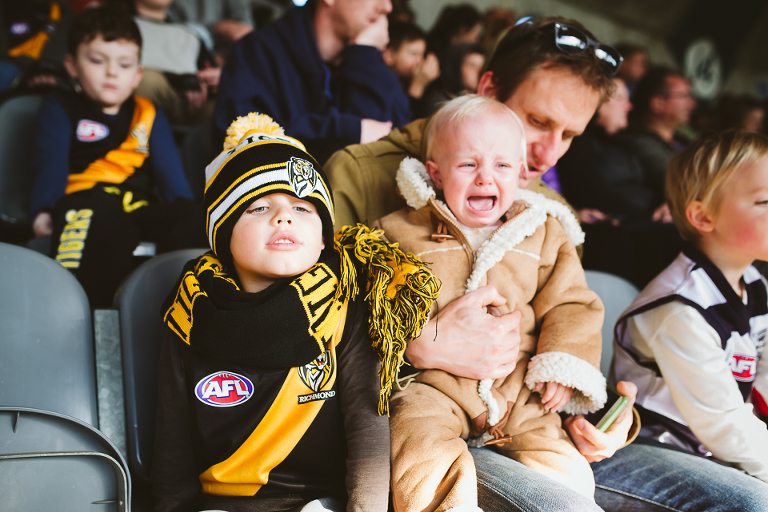 Angry child at sporting event - Documentary Family Photography