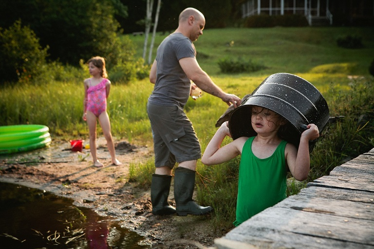 girl with bucket on head - Documentary Family Photography - Sham of the Perfect