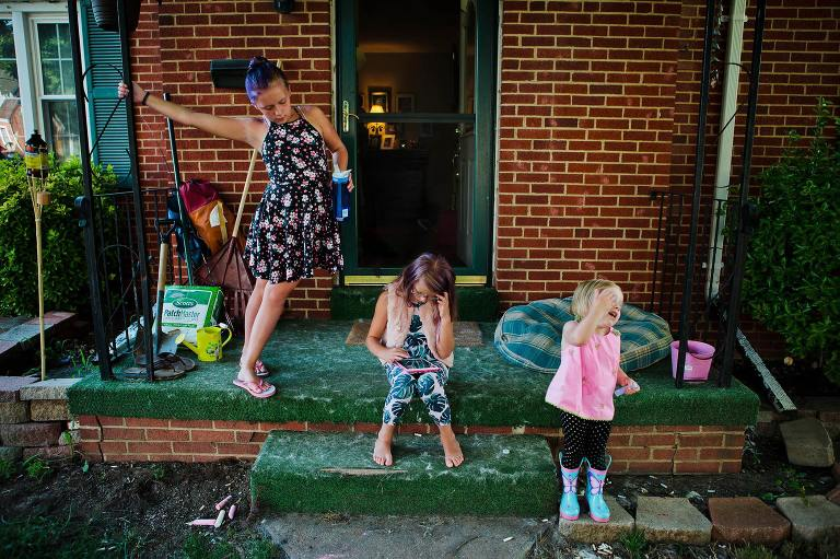 kids playing on porch - Documentary Family Photography