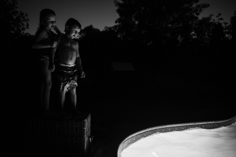 kids near pool at night - Documentary Family Photography