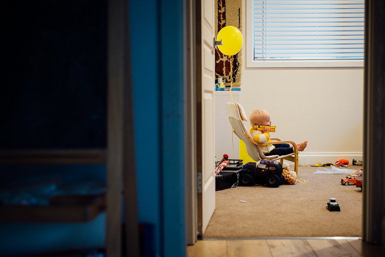 toddler in child size chair - Documentary Family Photography
