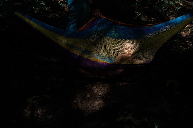 girl tangled in hammock - Documentary Family Photography