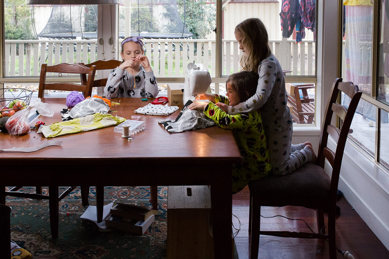 Kids at kitchen table sewing - Documentary Family Photography