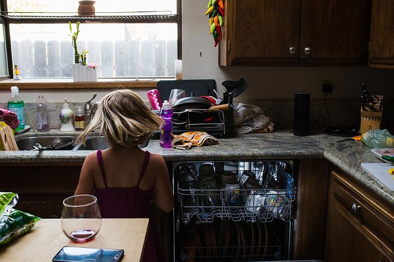 girl unloads dishwasher - Documentary Family Photography