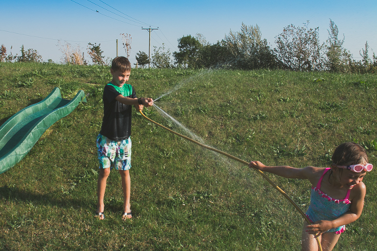 kids play in hose - Documentary Family Photography