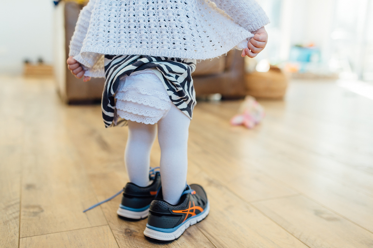 baby in brother's sneakers - Documentary Family Photography