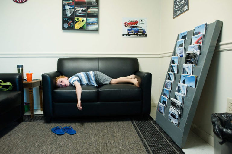 kid bored in waiting room - Documentary Family Photography