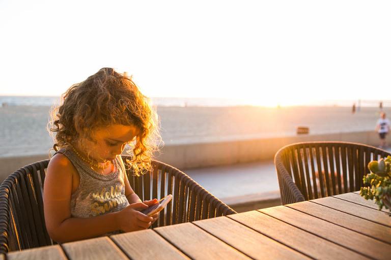 girl on phone - Documentary Family Photography