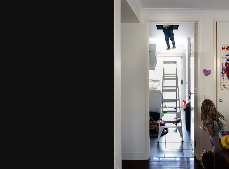 child hanging from attic - Documentary Family Photography