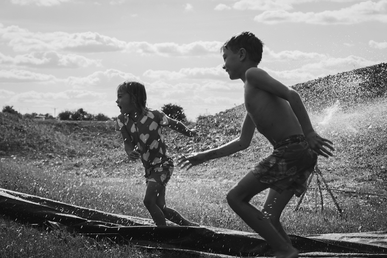 kids play in water - Documentary Family Photography