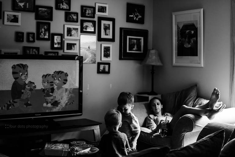 tired mother watches children - Documentary Family Photography