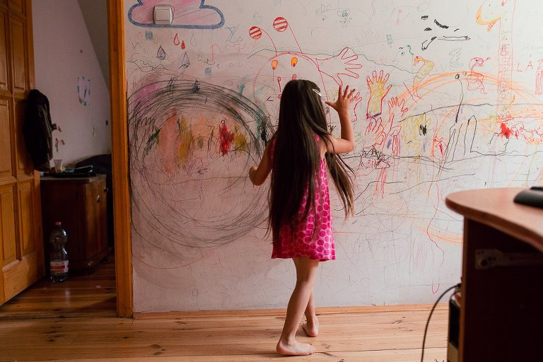 girl at art wall - Documentary Family Photography