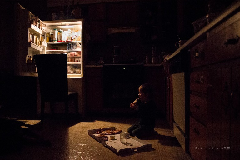 child eats late night pizza - Documentary Family Photography