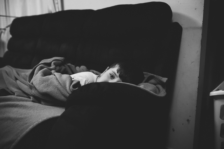boy laying on couch - Documentary Family Photogarphy