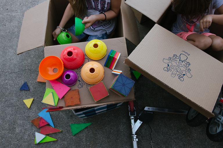 kids play with colored toys and boxes - Documentary Family Photogarphy