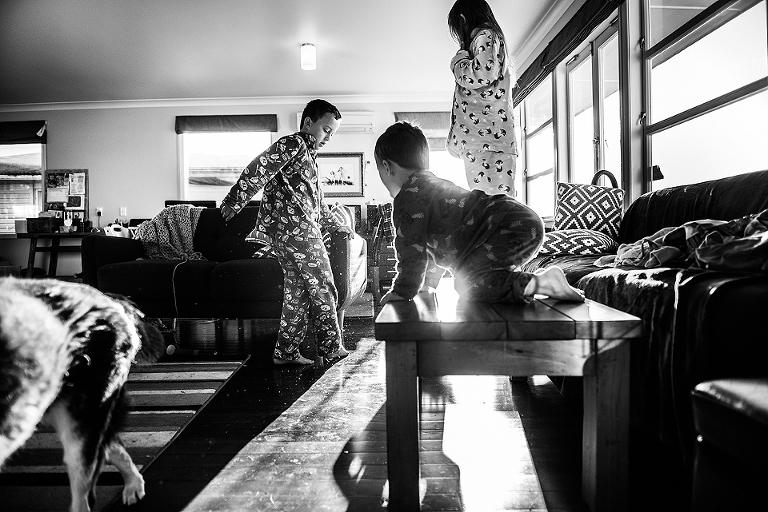 kids climbing on furniture in pajamas