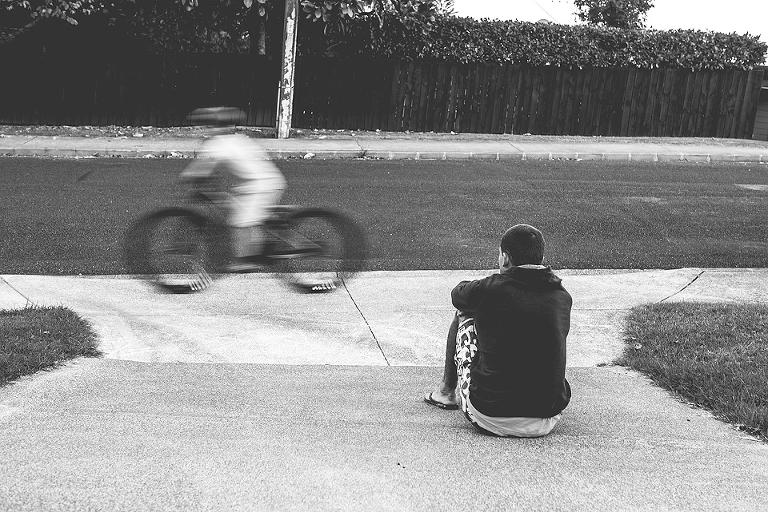 child riding bike as friend watches