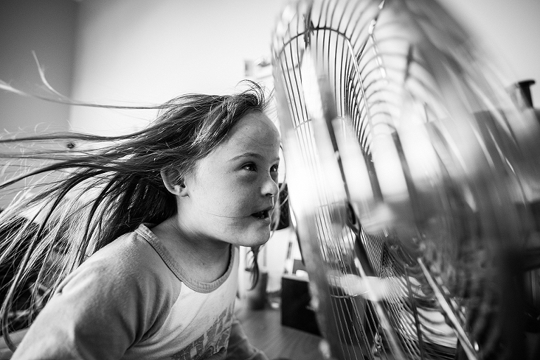 girl at fan - Documentary Family Photography