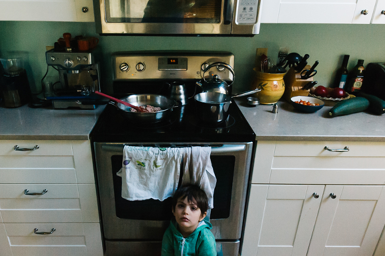 boy waits impatiently for dinner - Documentary Family Photography
