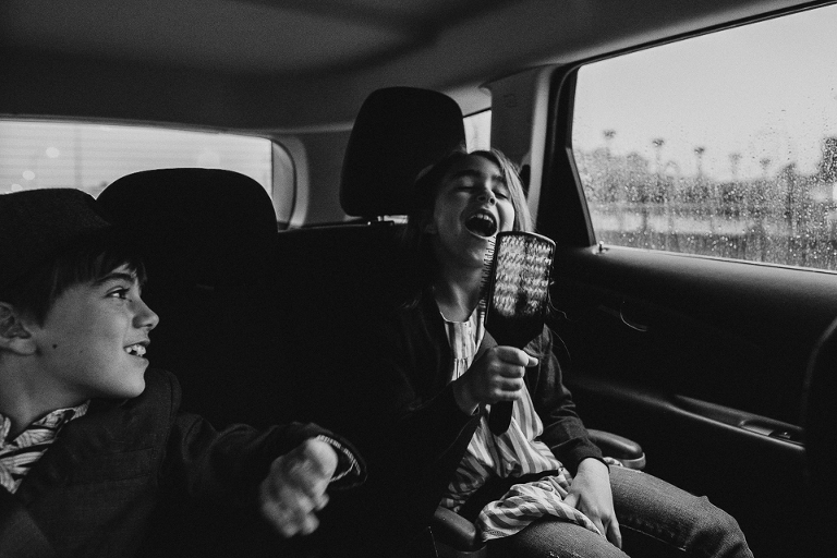 girl singing in backseat - Documentary Family Photography