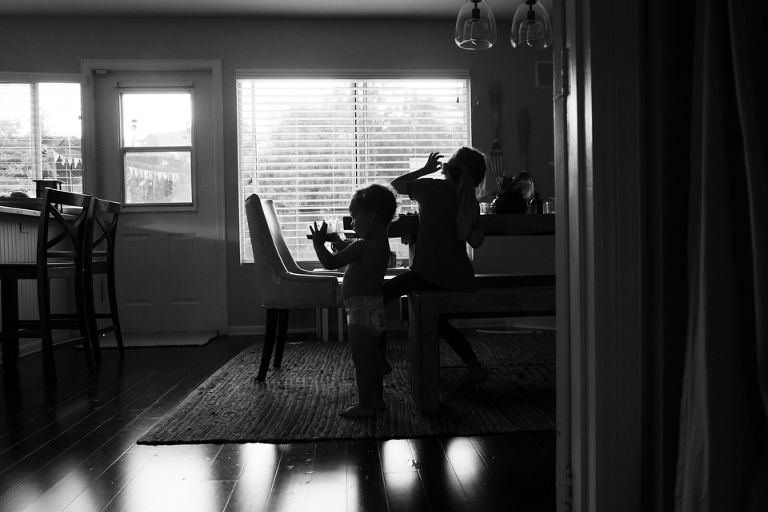 silhouette of kids in living room - Documentary Family Photography